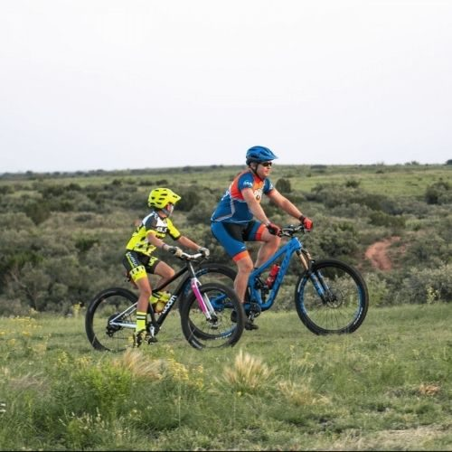 man and a kid riding bikes